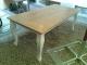 tafel van steigerhout met verstekblad en witte krulpoten